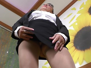 Sweet granny Karina G pleases the brush hairy pussy with a toy