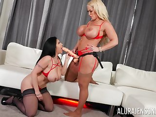 Hot milfs share the strap-on in seductive lesbian play
