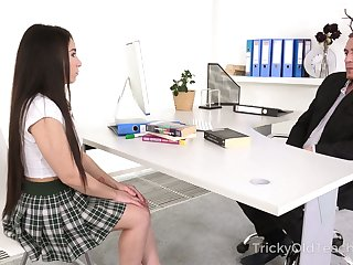 Naughty coed girl Kandy Kors is fucked missionary germane on the desk
