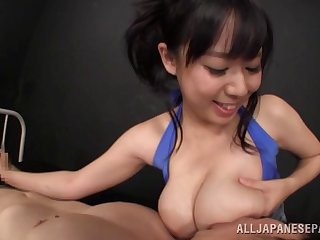 Bubbly Japanese beauty gets her tits licked while giving a handjob