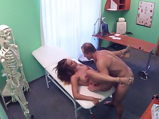 Sexy spoil handles her physician's penis during a monthly check