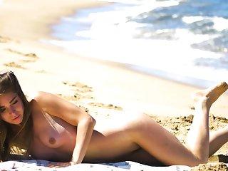Petite body MILF Lily Chey suntanning on hammer away beach