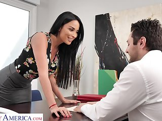 Femme fatale woman Anissa Kate offers herself sitting on rub-down the boss's table