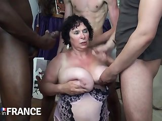 Horny granny fucked away from two strong young guys